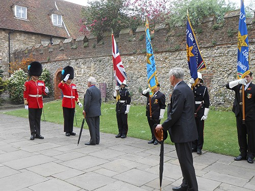 Sir Michael Howard, Guest of honour, inspecting standards and speaking with RSM from the Irish Guards, prior to service at Chichester cathedral